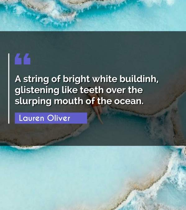 A string of bright white buildinh, glistening like teeth over the slurping mouth of the ocean.